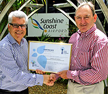 Peter Pallot (left) receives the certificate from Dennis Chant