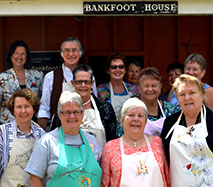 Caloundra Embroiders model their aprons at Bankfoot House