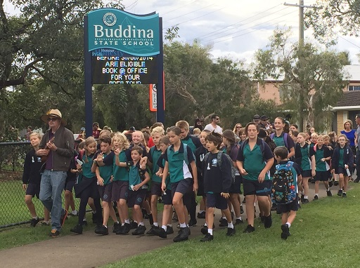 Buddina State School students round the bend toward the school gate on Walk Safely to School Day 2018